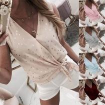 Top Doux à la Mode Sans Manches Encolure V à Pois avec un Nœud sur l'Ourlet